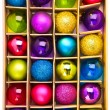 Art gift box with bright colored Christmas balls — 图库照片