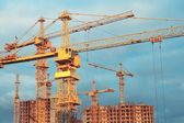 Construction cranes and bulding — Stock Photo