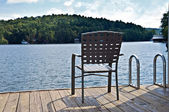 Chair on Dock at Waters Edge — Stock Photo