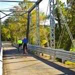 Bicycle Riders on Bridge — Stock Photo