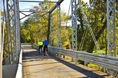 Bicycle Riders on Bridge — Stock Photo
