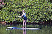 Woman on a Paddle Board — Stock Photo