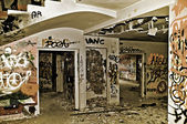Graffitis in an abandonded house — Stock Photo