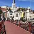 Red footbridge and church - Stock Photo