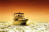 Boat and sunset — Stock Photo