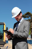 On building site with hardhat — Stock Photo