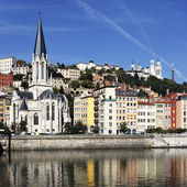 Saone river and church — Stock Photo