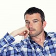 Pensive mwith blue shirt — Stockfoto #7604390