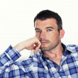 Foto de Stock  : Pensive mwith blue shirt