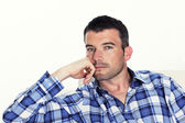 Pensive man with blue shirt — Stock Photo