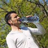Drinking in a park — Stock Photo