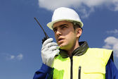 Builder with transmitter — Stockfoto