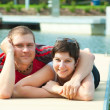 Young pair on harbor pier — Stock Photo
