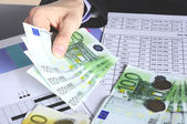 Hand with euro money — Stockfoto
