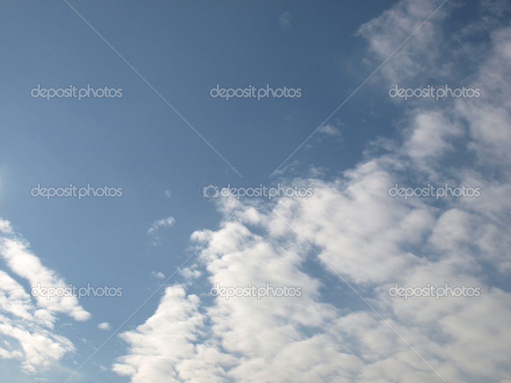 Blue sky with white clouds, useful as a background — Stock Photo #7497357