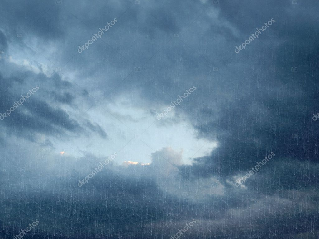 Heavy rain over a dark cloudy sky  Stock Photo #7506560