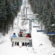 Stock Photo: Skiers in chairlift