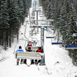 Skiers in chairlift — Stock Photo