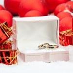 Wedding rings among Christmas decorations — Stock Photo