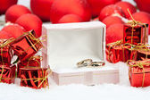 Wedding rings among Christmas decorations — Stock Photo