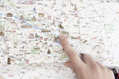 Finger in the map — Stock Photo