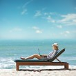 Young woman with laptop at the beach — Stock Photo