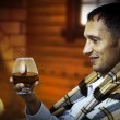 Taster. Man with glass of brandy or cognac - Stock Photo