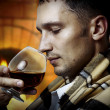 Taster. Man with glass of brandy or cognac — Stock Photo #6763025