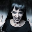 Horror and halloween concept. Female vampire — Stock Photo #6789983