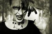 Fashion portrait of sexy female vampire — Stock Photo