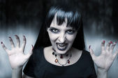 Horror and halloween concept. Female vampire — Stock Photo