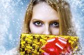 Makeup for eyes and christmas giftbox — Stock Photo