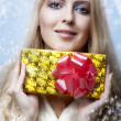 Christmas concept. happy woman with gift — Stock Photo #7201760