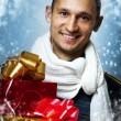 Man with two christmas gift boxes — Stock Photo