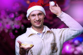 Young adult man in santa claus hat — Stock Photo