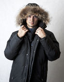 Man in black fur hood winter jacket — Stock Photo