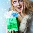 Beautiful woman winner holding money — Stock Photo