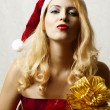 Sexy blond woman in santa claus hat — Stock Photo #7354868