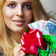 Woman with money (euro) and christmas gift — Stock Photo