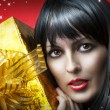 Portrait of beauty woman with gold christmas gift — Stock Photo