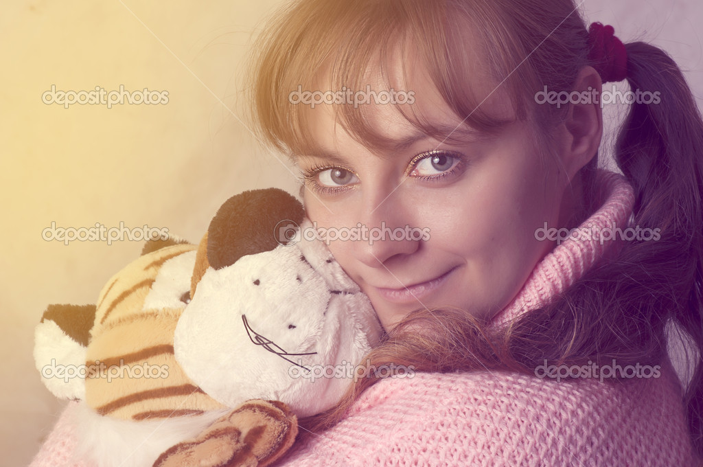 Vanilla portrait of young attractive woman with soft toy in hands. Little girl style — Stock Photo #7597026
