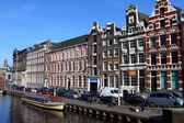Quiet Amsterdam canal with house boats — Stock Photo