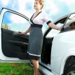 Freedom. Woman standing near her sport auto outdoor under sky — Stockfoto