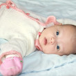 Beautiful three month baby girl lying on the bed — Stock Photo