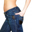 Beautiful slim woman with hand in back of jeans pocket isolated — Stock Photo