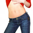 Sexy fit young woman undressing her red blouse and blue jeans is — Stock Photo