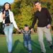 Family Enjoying Walk In autumn Park — Stock Photo #7103833