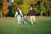 Family Enjoying Walk In autumn Park — Stock Photo
