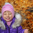 Happiness a child smiling in the autumn park — Stock Photo #7244372