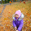 Happiness a child smiling in the autumn park — Stock Photo